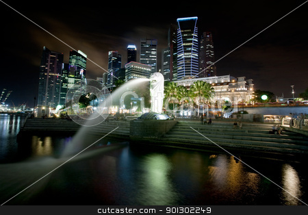 Singapore Cityscape stock photo, A view of singapore at night with the merlion in the foreground by Tyler Olson