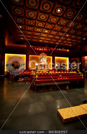 Buddhist Temple Interior stock photo, An interior of a buddhist temple with low lighting by Tyler Olson