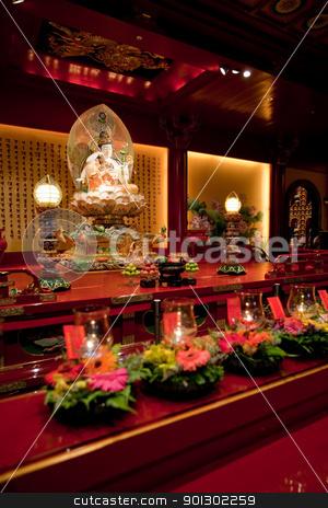 Buddhist Temple Interior stock photo, An interior of a Buddhist temple with a Buddha statue by Tyler Olson