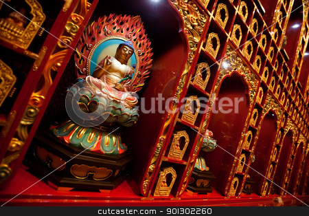 Buddha Statue stock photo, An interior of a buddhist temple with many Buddha statues. by Tyler Olson