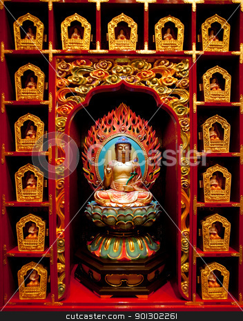 Buddha stock photo, Buddha statues in a display case in a temple by Tyler Olson