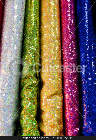Cloth Sparkle stock photo, An abstract background of various rolls of cloth by Tyler Olson