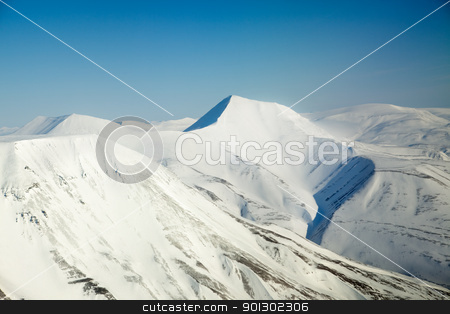 Snow Mountain Range stock photo, A snow covered mountain range in Svalbard by Tyler Olson