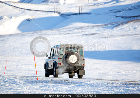 Extreme Winter Truck stock photo, A truck driving on a barren landscape of snow and ice - Svalbard, Norway by Tyler Olson