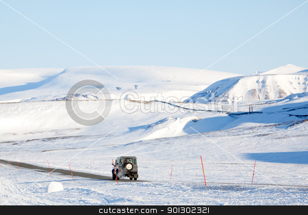 Barren Landscape stock photo, A truck driving on a barren landscape of snow and ice - Svalbard, Norway by Tyler Olson