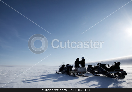 Polar Expedition stock photo, A winter adventure guide on a barren winter landscape by Tyler Olson