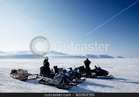 Polar Expedition stock photo, An expedition over a polar winter landscape with frozen ice by Tyler Olson
