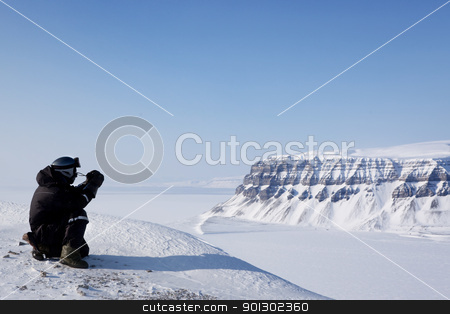 Wilderness Guide stock photo, A winter wilderness adventure guide.  Spitsbergen, Svalbard, Norway by Tyler Olson