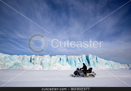 Glacier with Snowmobile stock photo, A glacier in Svalbard, Norway with a skidoo travelling on the ice by Tyler Olson