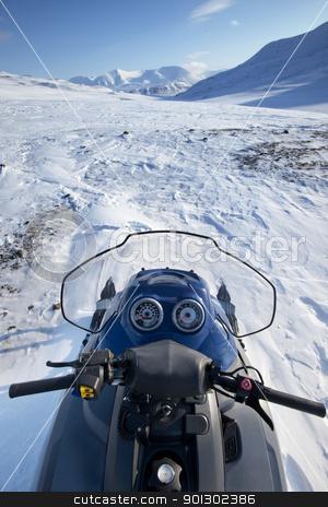 Snowmobile Winter Landscape stock photo, A snowmobile on a winter wilderness landscape by Tyler Olson