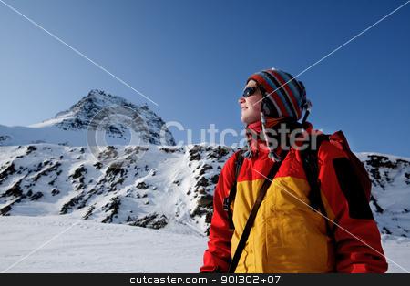 Winter Woman Portrait stock photo, A portrait of a female adventurer against a mountain landscape by Tyler Olson