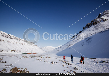 Svalbard stock photo, A group of people walking along a path ouside Longyearbyen, Spitsbergen, Svalbard, Norway by Tyler Olson