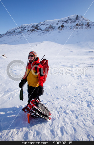 Female Mountaineer stock photo, A portrait of a female adventurer against a mountain landscape by Tyler Olson
