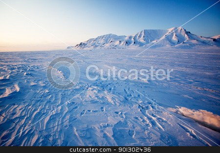 Winter Sunset Landscape stock photo, A landscape on the island of Spitsbergen, Svalbard, Norway late at night. View from Longyearbyen. by Tyler Olson