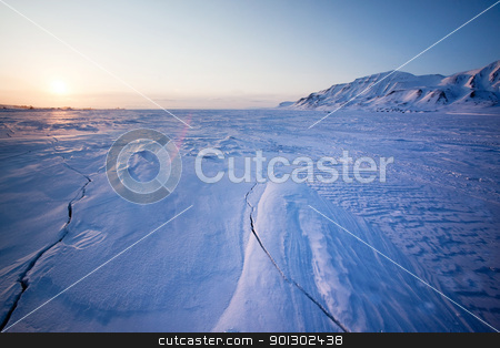 Frozen Ice Landscape stock photo, A landscape on the island of Spitsbergen, Svalbard, Norway late at night. View from Longyearbyen. by Tyler Olson