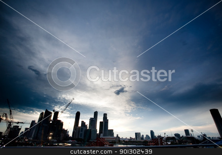 Singapore Skyline stock photo, Singpore skyline in dramatic clouds - silhouette by Tyler Olson