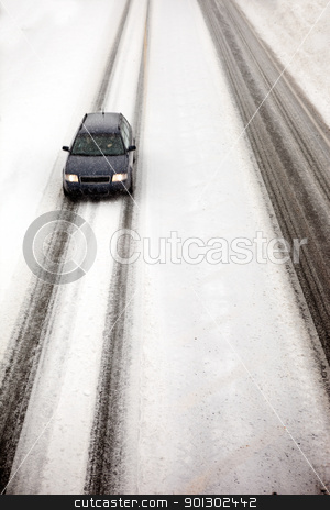 Car in Snow Storm stock photo, A car travelling in a snow storm by Tyler Olson