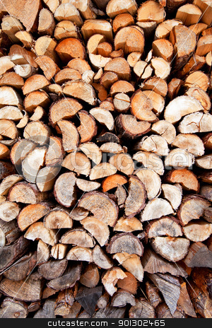 Firewood Background stock photo, An abstract background of firewood stacked by Tyler Olson