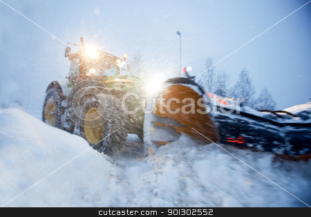 Snow Plow stock photo, A snow plow clearing a road in winter by Tyler Olson
