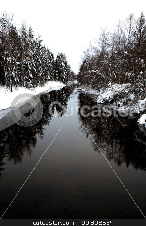 Winter Stream stock photo, A cold winter river with a grey sky by Tyler Olson