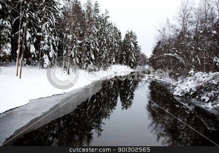 Winter River stock photo, A cold winter river with a grey sky by Tyler Olson