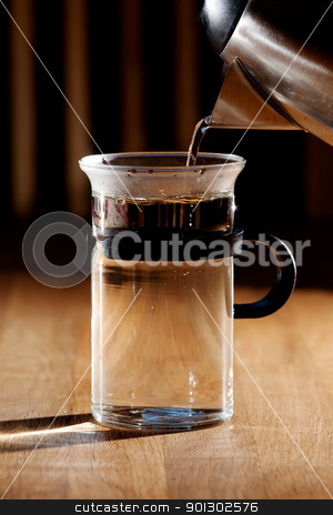 Hot Water stock photo, Early morning tea - glass being filled with water with strong directional  morning light by Tyler Olson