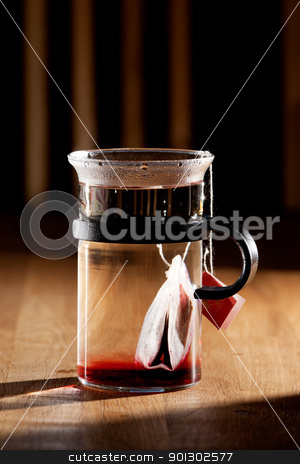 Morning Tea stock photo, A tea bag in a cup of hot water with strong directional morning light by Tyler Olson