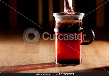 Tea stock photo, A tea bag in a cup of hot water with strong directional morning light by Tyler Olson