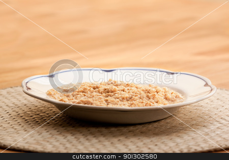 Porridge stock photo, A bowl of porridge on a wooden table. by Tyler Olson
