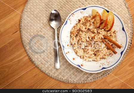 Bowl of Porridge stock photo, A bowl of porridge with apple and cinnamon spices by Tyler Olson