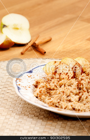 Apple Cinnamon Porridge stock photo, Apple Cinnamon Porridge with fresh ingredients in the background by Tyler Olson