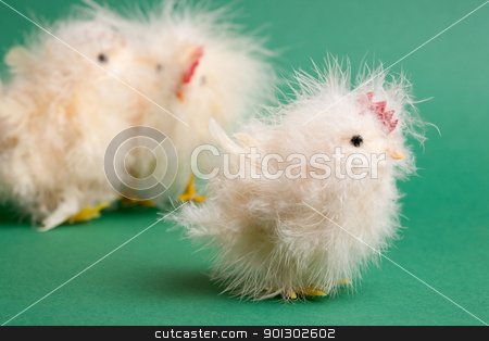 Chick stock photo, A little yellow chick easter decoration isolated on green by Tyler Olson