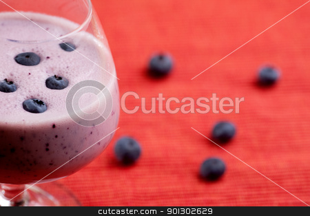 Blueberry Smoothie stock photo, A delicious blueberry smoothie over a red cloth background by Tyler Olson