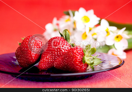 Strawberries stock photo, A plate of fresh strawberries with flower in the background by Tyler Olson