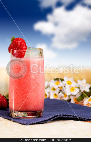 Strawberry Smoothie stock photo, A fresh summer strawberry drink in an outdoor setting by Tyler Olson