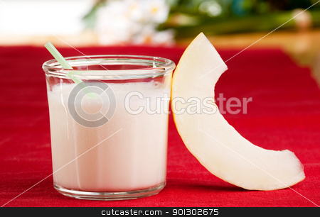 Melon Smoothie stock photo, A sweet melon smoothie in an outdoor setting by Tyler Olson
