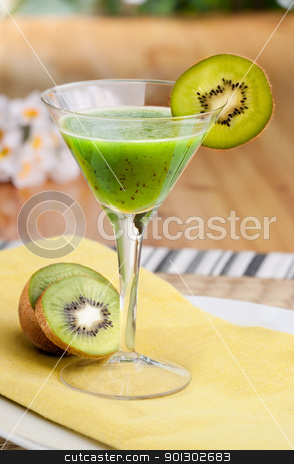 Kiwi Fruit Punch stock photo, A kiwi based fruit drink in a martini glass by Tyler Olson