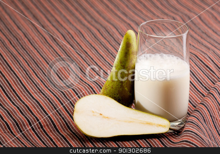 Pear Smoothie stock photo, A pear smoothie on a stripped table cloth by Tyler Olson