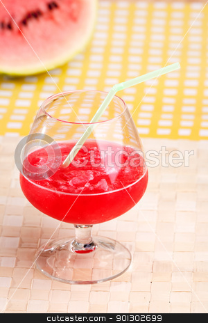 Watermelon Drink stock photo, A red watermelon drink on a picnic table by Tyler Olson