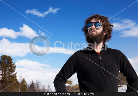 Winter Adventure Male stock photo, A male standing in a winter landscape ready for adventure by Tyler Olson