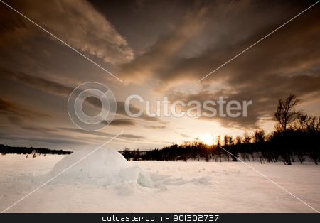 Igloo stock photo, An ingloo against a dramatic sunset by Tyler Olson