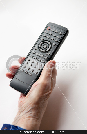 Remote Control Elderly stock photo, An elderly hand with a TV DVD remote control by Tyler Olson