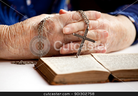 Hands with Cross stock photo, An elderly pair of hands holding a cross by Tyler Olson