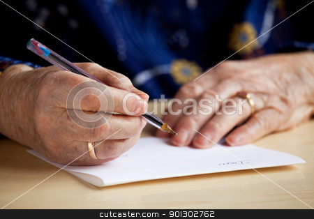 Writing a Letter stock photo, An old pair of hands writing a letter by Tyler Olson
