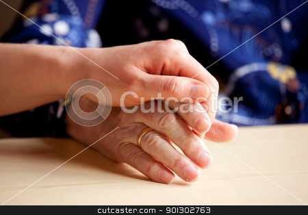 Comfort stock photo, A young hand comforts and elderly hand by Tyler Olson