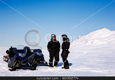 Winter Adventure stock photo, A group on a winter snowmobile adventure over a barren winter landscape by Tyler Olson