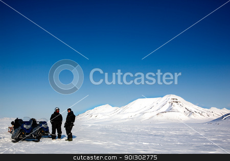Snowmobile Tour stock photo, Two men on a snowmobile trip on Svalbard, Norway by Tyler Olson