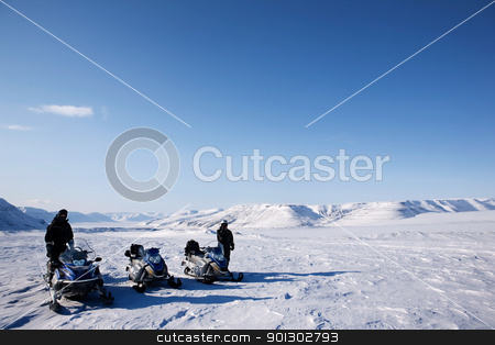 Snowmobile Winter Landscape stock photo, A group of people on a snowmobile trip in a winter landscape by Tyler Olson