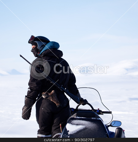 Arctic Guide stock photo, An arctic guide equiped with a rifle, looks out on the horizon by Tyler Olson