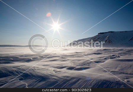 Frozen Arctic Landscape stock photo, A dramatic winter landscape from the Arctic, Svalbard, Norway by Tyler Olson